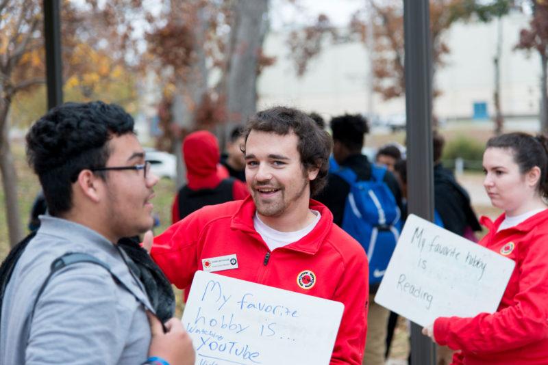 City Year volunteer Shawn Wiyninger greets a student at Webster High School.