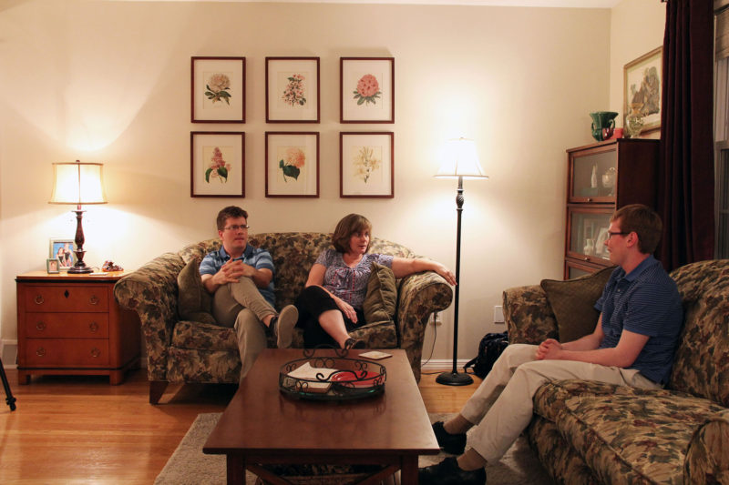 Peter O'Halloran, a young adult with a disability, sits with his family in their house in the suburbs of Philadelphia. He is saving money to buy his own home.