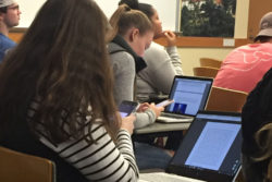 Students in a marketing course at Roger Williams University in Rhode Island check their phones before class begins. To tame classroom distraction, their professor uses Flipd, an app that locks students out of their phones during class.