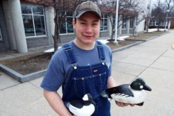 James Lawrence, a 2017 graduate of the Traip Academy in Kittery, Maine, holds wooden duck decoys he made for an art credit his senior year.
