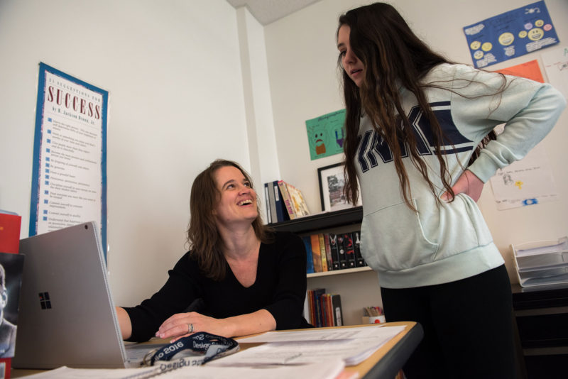 Sanborn Regional High School social studies teacher Donna Harvey-Moseley works with sophomore Zoey Emerson on a research project about the American Civil War.