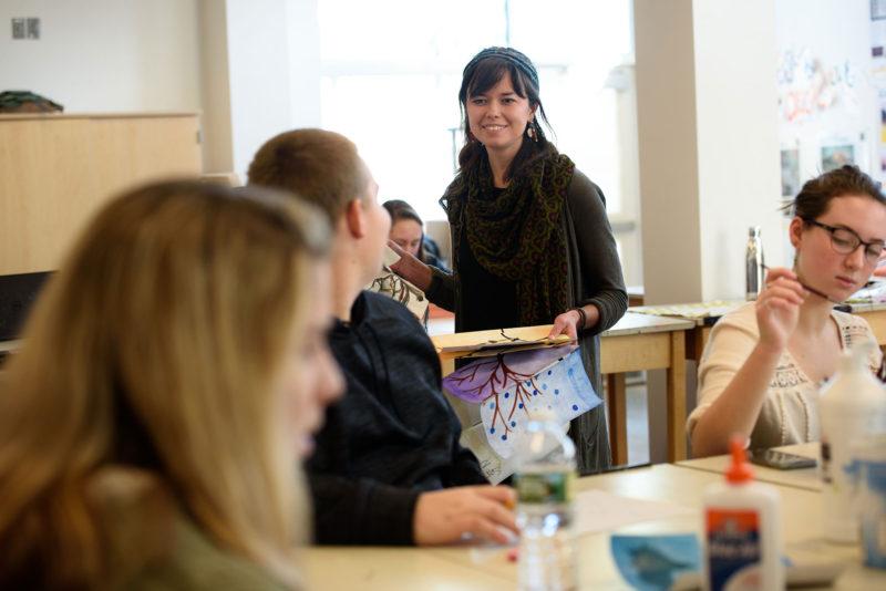 Sanborn Regional High School art teacher Jillian Swist works with students.