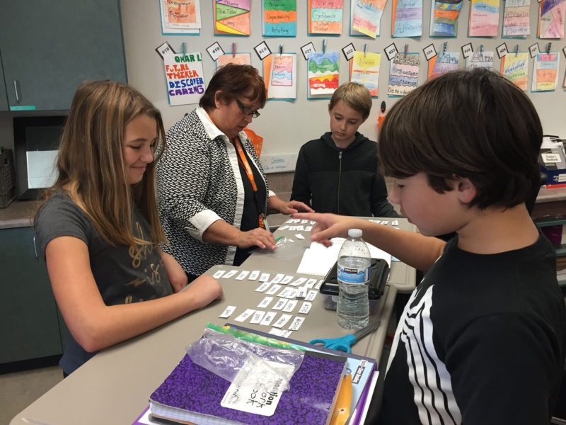 """Audrianna Lesieur, age 11, smiles after demonstrating the strength of """"Confidence"""" with encouragement from classmate William Maestas as her teacher Val Seamons moves on to assist Billy Sabo at Lake Canyon Elementary School."""