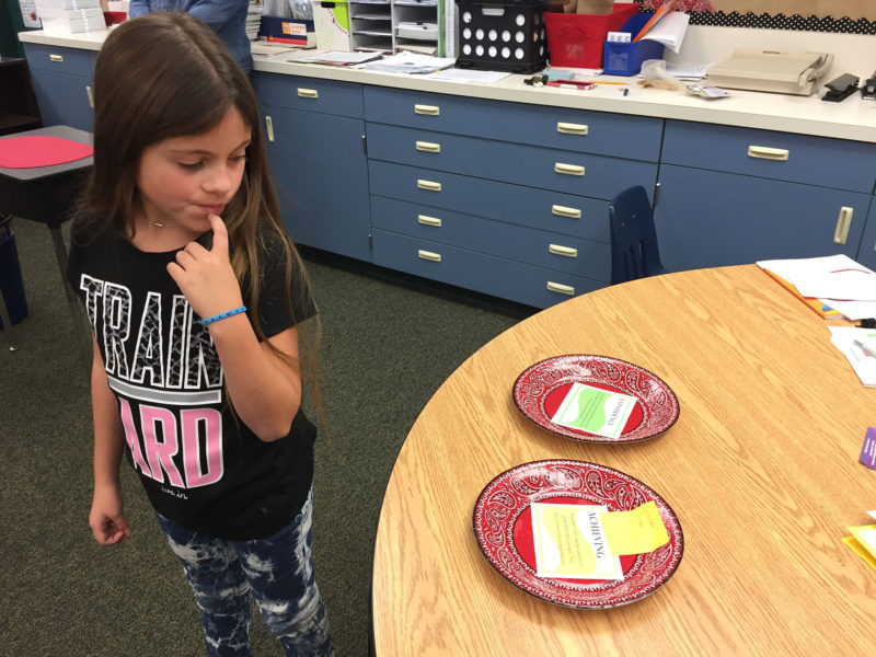 """Gianna Gomez, age 7, pauses to reconsider after claiming """"Achieving"""" as her top strength at Greer Elementary School."""