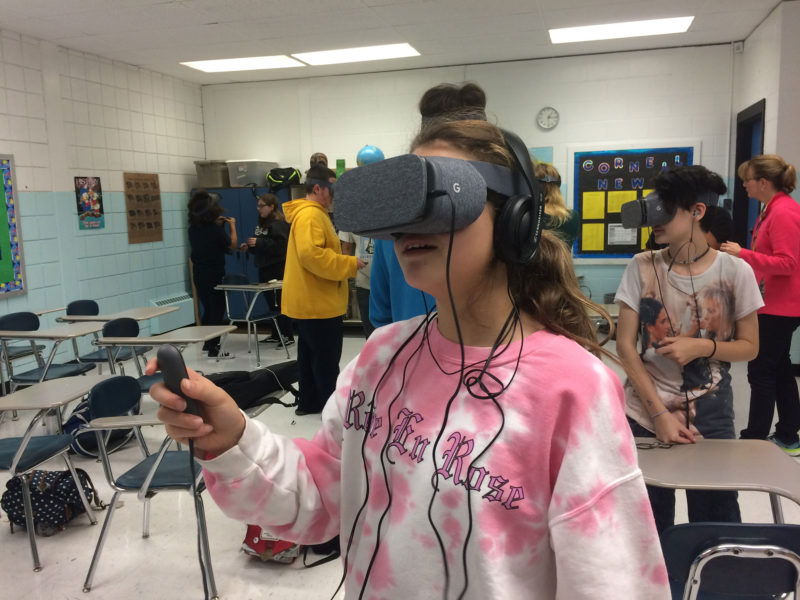 Cornell eighth-grader Jada Jenkins uses a hand controller to communicate with other students and navigate through a forest in the Voyage virtual field trip.