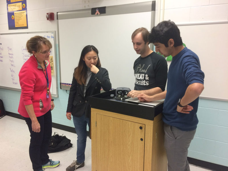 Cornell School District science teacher Susan Dunning, left, and Carnegie Mellon University Entertainment Technology Center graduate students, Na-yeon Kim, Julian Korzeniowsky and Sharan Shodhan, check an iPad to see where students are within the virtual reality experience.