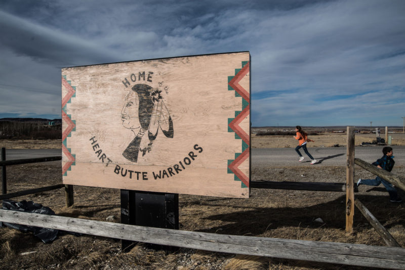 A girl at recess runs at the Heart Butte School on the Blackfeet Indian Reservation in northern Montana. Overshadowed by attention to the challenges faced by nonwhite high school graduates in cities, low-income black, Hispanic and native American students in rural areas are equally unlikely to go on to college.
