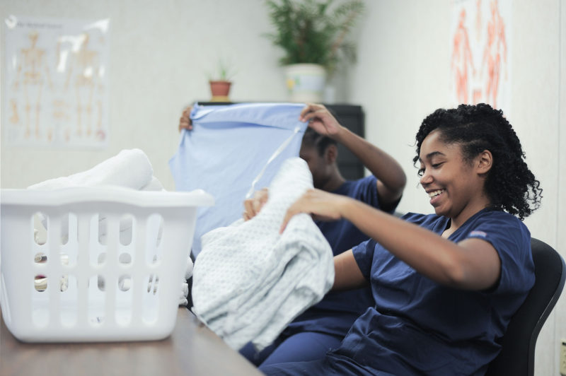 Chelsey Houston, 20, and Siera Gunn, 23, fold linens at West Georgia Technical College to prepare for a test to become nurses' aides.