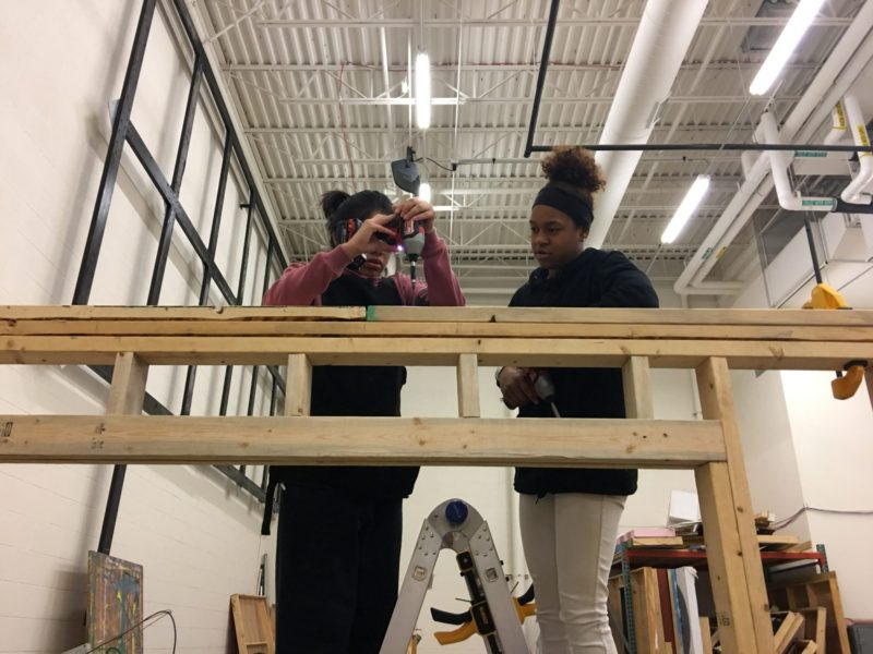 "High school junior Tania Toriz, 16, and sophomore Jade Boling, 15, fix a screw on the top of a shed that their ""Geometry in Construction"" class constructed at Ritenour High School near St. Louis, Missouri."