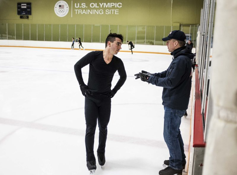 Olympic hopeful figure skater Max Aaron, with his coach at the practice rink in Colorado Springs, earned a degree in finance in December at 25. He worked as a barback and a waiter on the weekends to help pay the tuition and took his classes early in the morning and late at night to accommodate his training schedule.
