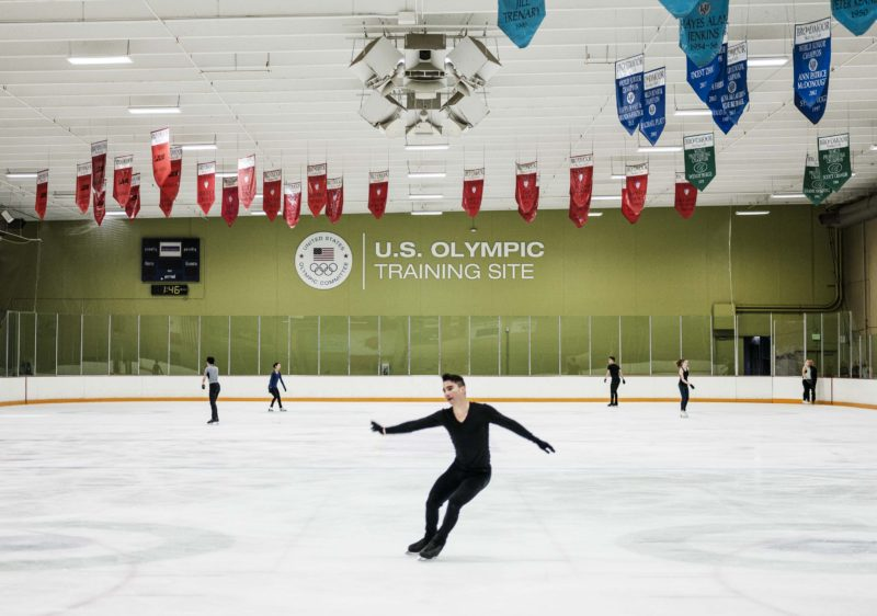 Olympic hopeful figure skater Max Aaron on the practice rink in Colorado Springs. Aaron, who is 25, earned a degree in finance in December. He worked as a barback and a waiter on the weekends to help pay the tuition and took his classes early in the morning and late at night to accommodate his training schedule.