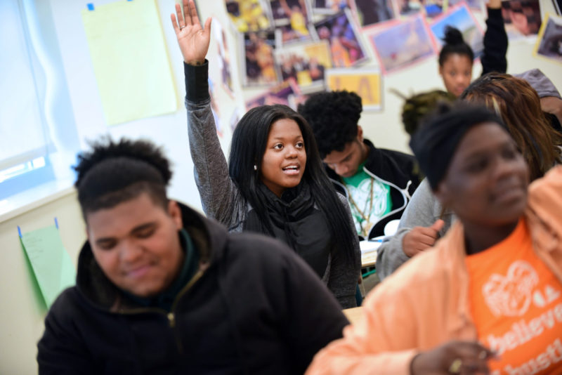Domonique Crosby raises her hand in calculus class at George Washington Carver High School.