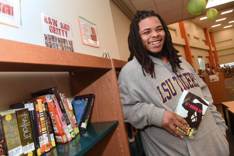 Rory Williams stands in the library at George Washington Carver High School.