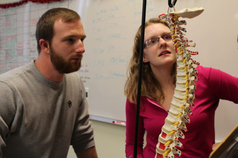 Students Matthew Amnott and Brittany Parmelee work on a group project inside a physical therapy class at the University of Maine at Presque Isle.