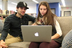Junior Alex DesRuisseaux and senior Jesus Garcia work in the library of the University of Maine at Presque Isle.