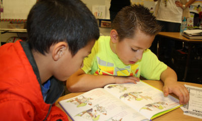 Third-graders at Alamosa Elementary School in Albuquerque practice reading with first-graders in Carrie Ramirez's classroom.