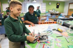 Fifth-grader Camar Graves adjusts his Lego robot in a robotics class at Elm City College Prep, in New Haven, Connecticut.