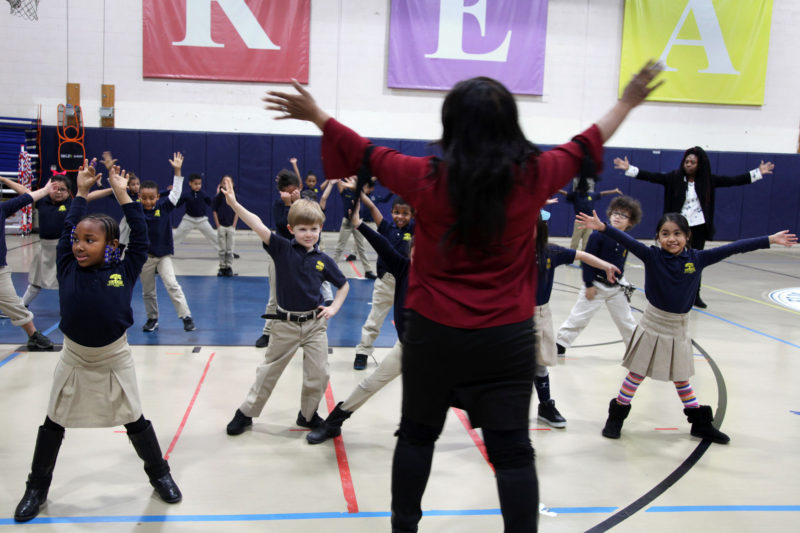 First-graders take part in a dance expedition led by classically trained ballet, tap and jazz dancer Alisa Bowens, at Elm City College Prep, in New Haven, Connecticut.