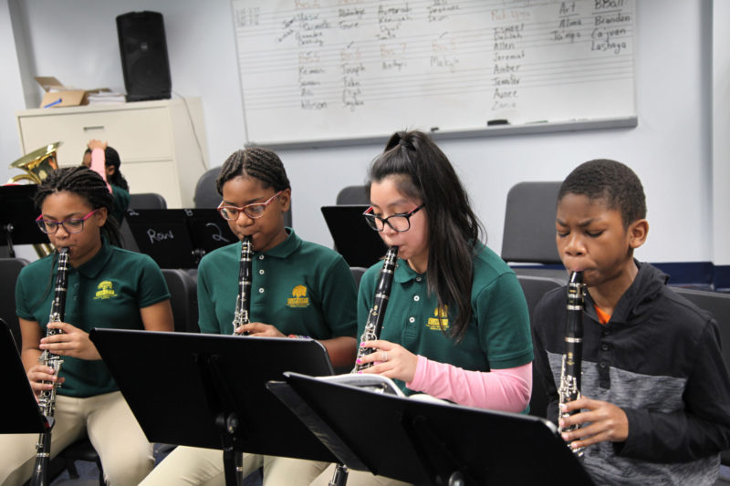 Fifth-graders (from left) Sanaii Harrison, Destinee Cummings, Sheyla Castelan and Toure Wright practice clarinet at Elm City College Prep, in New Haven, Connecticut.