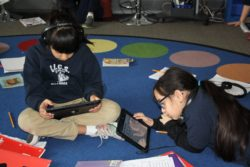 A new research project aims to figure out why particular ed tech initiatives succeed or fail. Students in a Chicago charter school work on tablets during class.