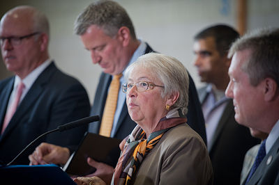 May 12, 2014 - New York City Schools Chancellor Carmen Farina speaks at a public school in Queens, accompanied by Mayor Mayor Bill de Blasio. Farina recently announced her retirement.