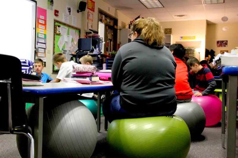 A row of exercise balls in a classroom at Kaleidoscope Academy. Studnets at Kaleidoscope can sit on these balls or even exercise bikes while in class.