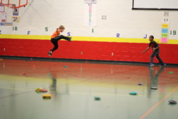 A student leaps during a game at Horizons Elementary School.