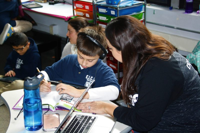 Kelly Pollack works with a student in CICS West Belden, a Chicago charter school that uses multiage classrooms as part of its personalized learning model.