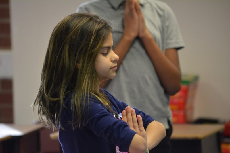 Melony Vega, a student at Haw River Elementary, doing yoga at an after-school club