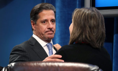 Miami-Dade Schools Superintendent Alberto Carvalho talks with a school board member after he announced he will turn down a job offer to become head of the New York City schools on March 1, 2018 in Miami, Florida. Mr. Carvalho made the announcement to not become New York City's schools chancellor during an emergency School Board meeting that had been called to discuss the news of the job offer.