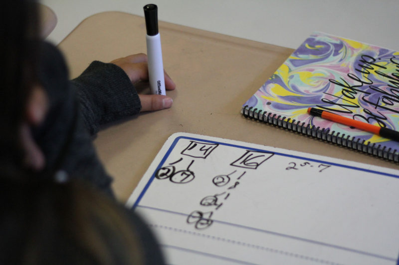 A middle-school student works on a math problem.