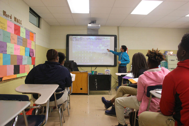 Iftikhar Azeem, a physics teacher at Holmes County Central High School, reviews a lesson with students.
