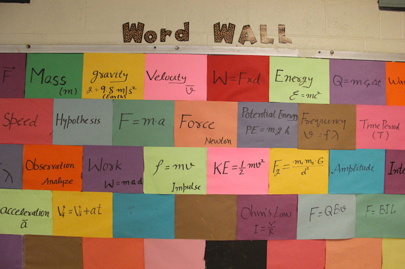 A word wall of physics vocabulary terms in a classroom at Holmes County Central High School.