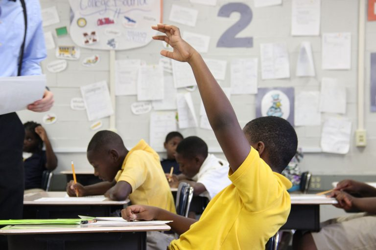 A student in the Mississippi Delta raises his hand during class. More than 40 school districts in the state, including many in the Delta, lack qualified teachers.