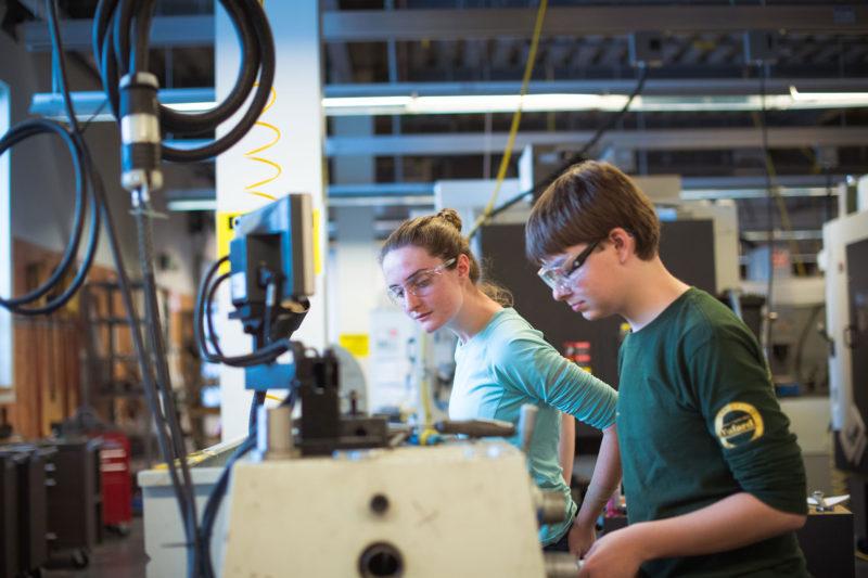 "Freshmen Helen ""Ellie"" Clark and Noah Stevens have class in the machine shop."