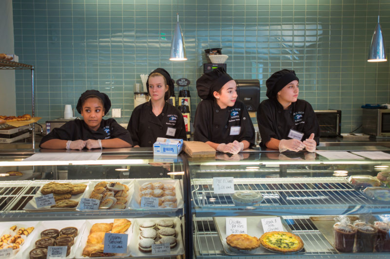 Freshmen in the Culinary Arts program, from left, Kiara Ovalle, of Salem, Haley Sorell, of Peabody, Hope Spencer, of Gloucester, and Jacqueline Nazzaro, of Peabody, wait for customers at the bakery counter.