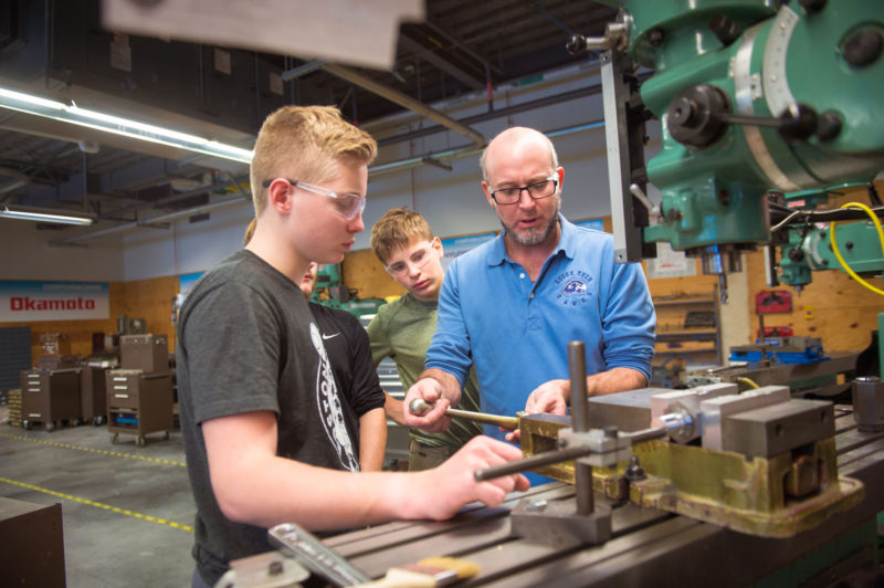 "Quinlan Roberts, left, and Nicolai ""Kolya"" Sims, both freshmen, work with Advanced Manufacturing teacher David Bailin. ""Do you want to know what makes him a good teacher?"" asked Sims. ""Quote this: 'Everything.' """