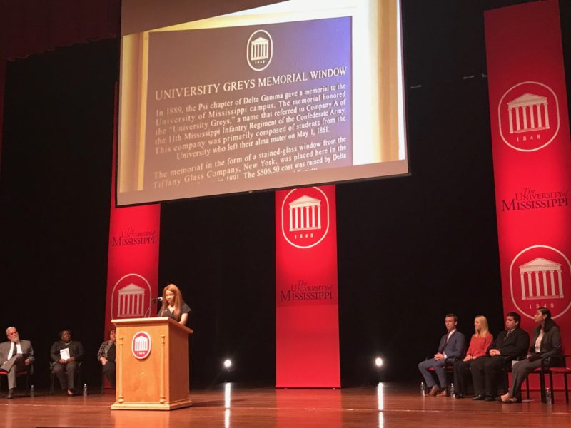 Nekkita Beans, president of the Black Student Union at the University of Mississippi, reads the text of a new plaque about the University Greys. The Greys fought for the Confederate Army.