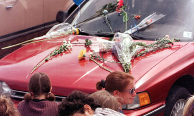 Columbine High School students mourn beside Rachel Scott's car at Clement Park near the high school. Scott was killed during the 1999 shooting rampage at the high school.