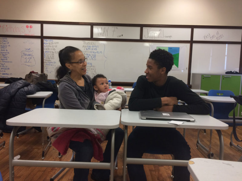 Ryan Moten, a freshman at Vaux, with his grandmother and baby sister, after he gave a school presentation about his plans for the future.