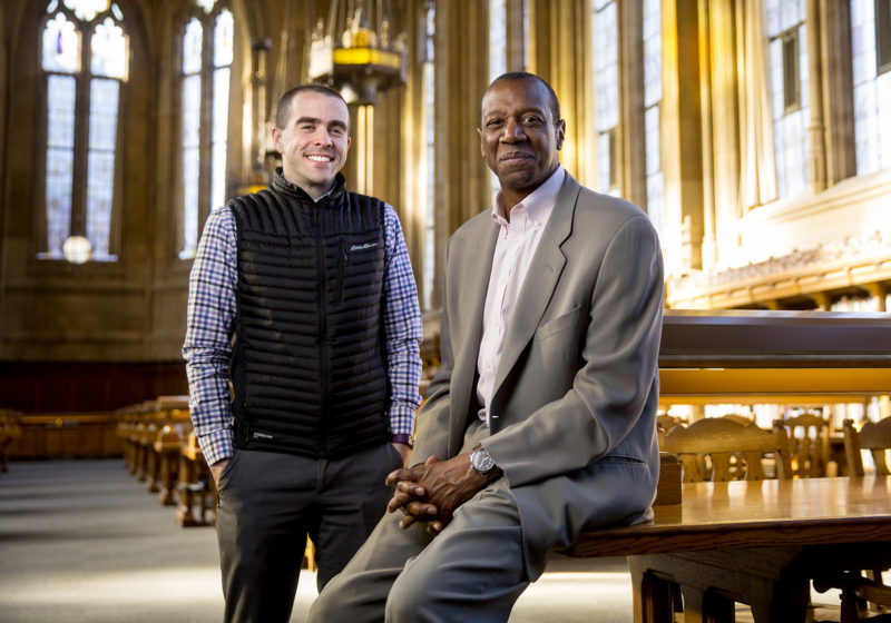 Ed Taylor, University of Washington vice provost and dean of undergraduate academic affairs, with Dan Feetham, director of undergraduate academic affairs advising, in the university's Suzzallo Library. Both are involved in efforts to help students graduate in four years.