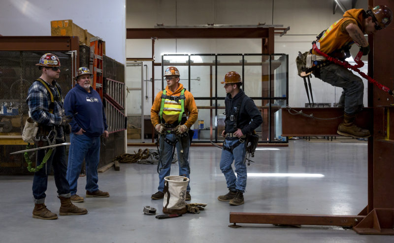 Ironworkers in an apprenticeship program near Seattle, where they're earning college credit, benefits and pay.
