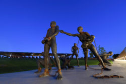 A sculpture by artist Kwame Akoto-Bamfo, part of the Nkyinkyim Installation, of enslaved people in chains is shown after entering The National Memorial for Peace and Justice on April 20, 2018 in Montgomery, Al.