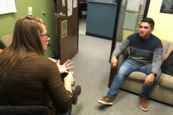 """""""Since my parents didn't get much education, it's hard to talk to them about my schoolwork and applying to college, or how to plan my time and get everything done,"""" says Mariano Almanza, 18, pictured speaking with his Coronado High School guidance counselor, Colleen McElvogue."""