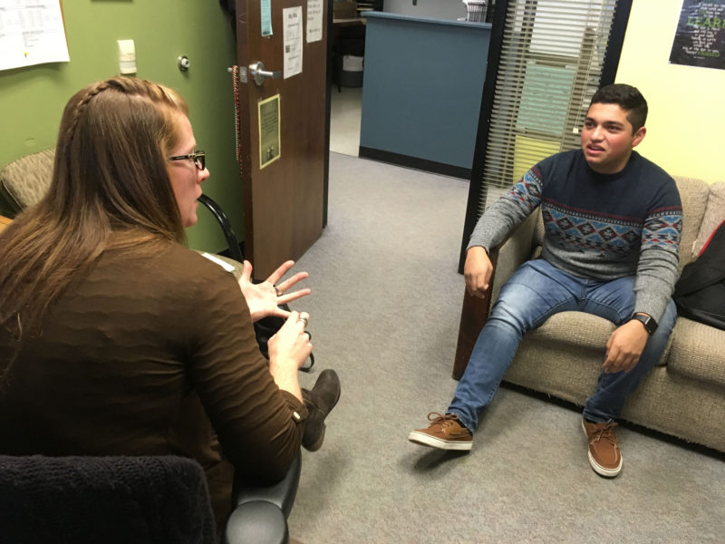 """Since my parents didn't get much education, it's hard to talk to them about my schoolwork and applying to college, or how to plan my time and get everything done,"" says Mariano Almanza, 18, pictured speaking with his Coronado High School guidance counselor, Colleen McElvogue."