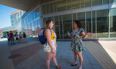 Elycea Almodovar, a junior at Salem State University, right, walks on campus with her roommate, Sabrina Ornae, a junior.Almodovar was drawn to the school because of its diversity.