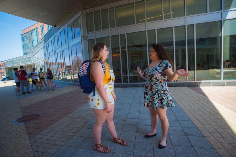 Elycea Almodovar, a junior at Salem State University, right, walks on campus with her roommate, Sabrina Ornae, a junior. Almodovar was drawn to the school because of its diversity.
