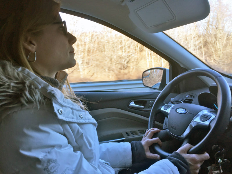 Private investigator Tina Blanchette rides around on a surveillance mission.