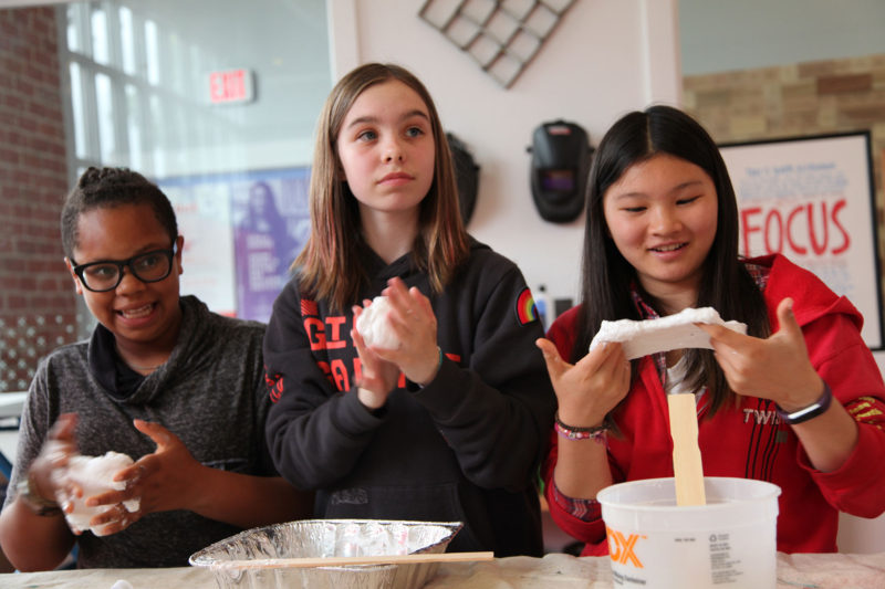 Students knead the slime they will use to test the gripping power of a mechanical claw they constructed at a workshop at Girls Garage, in Berkeley, California.