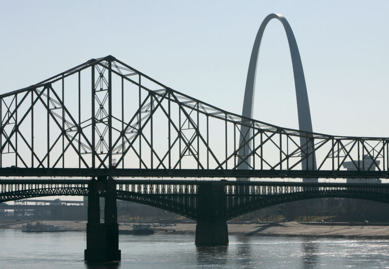 The Martin Luther King Bridge, top, and Eads Bridge, bottom, connect East St. Louis with downtown St. Louis. Little of the economic boom that has transformed St. Louis has made it across the river.